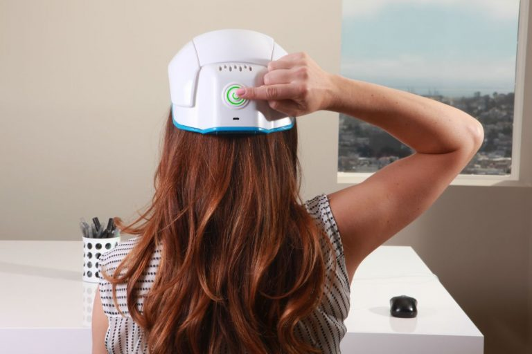 woman wearing helmet for hair loss